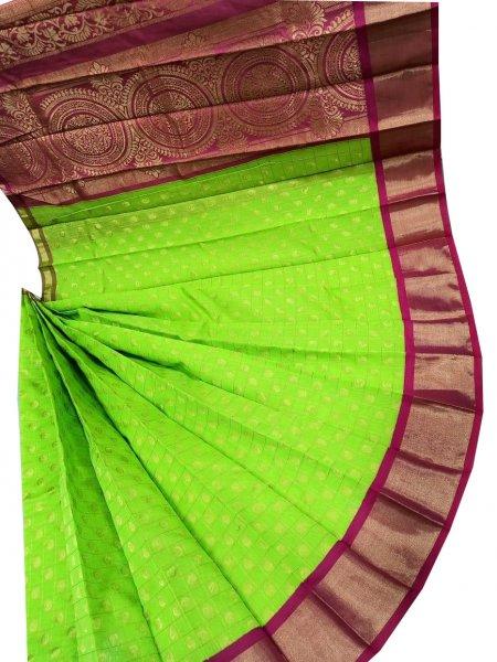 Green and purple chanderi kuppadam checks butta modal saree