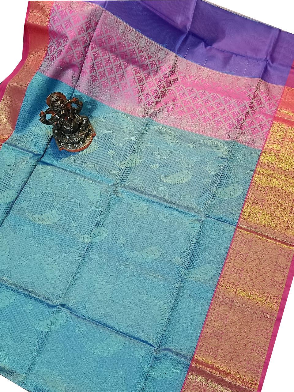 Ocean green, red and pink kora silk saree with kuppatam border