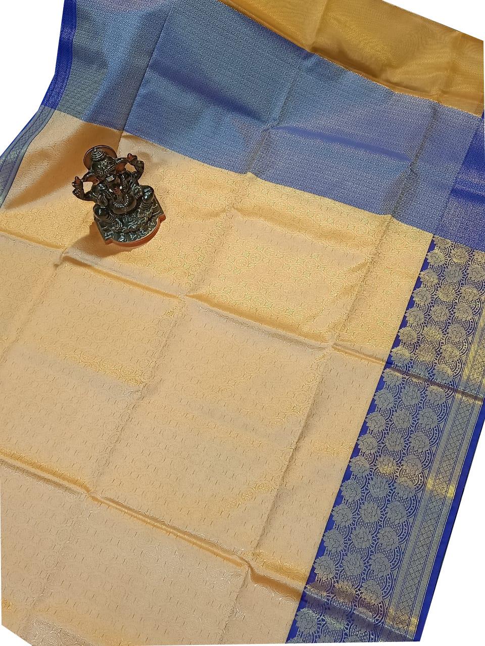 Cream and blue kora silk saree with kuppatam border