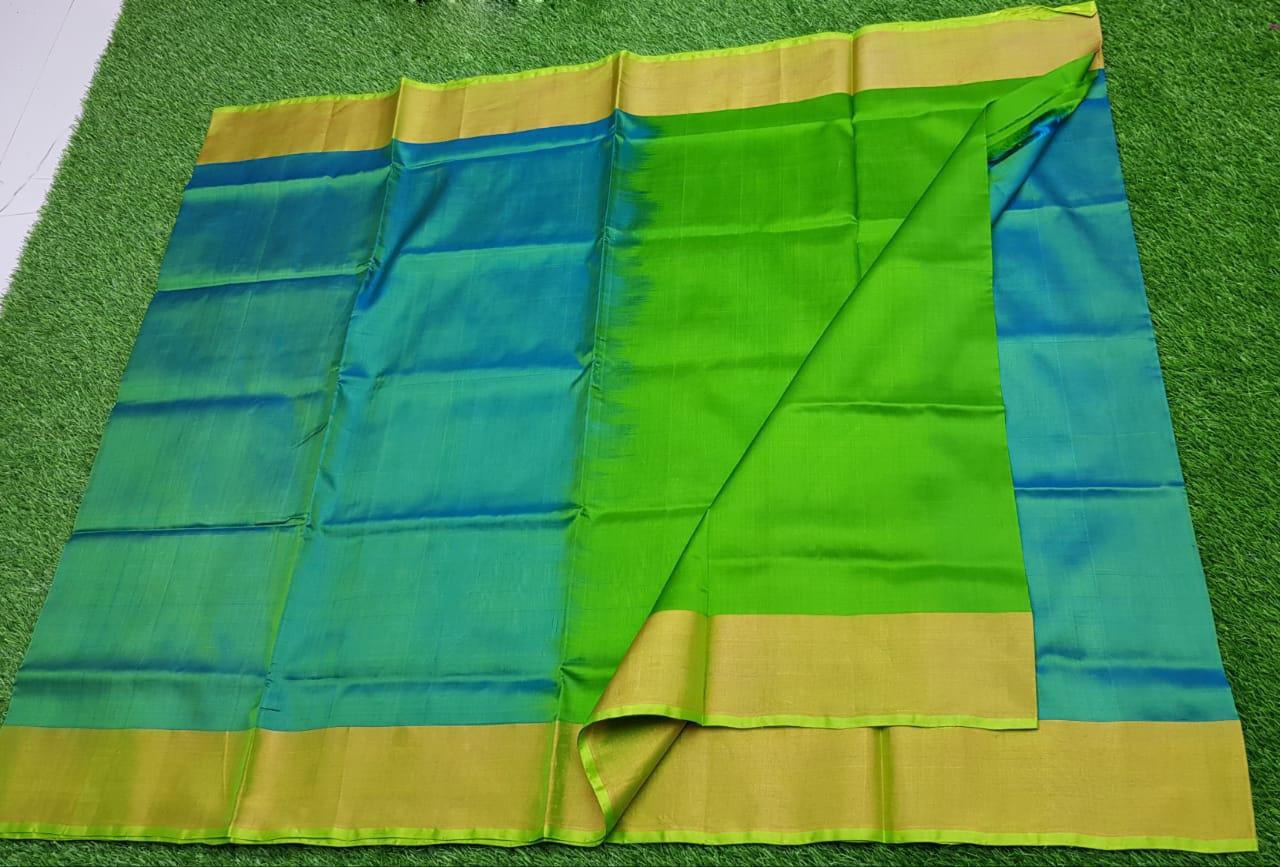 Sky blue and green uppada pure pattu with zari border saree
