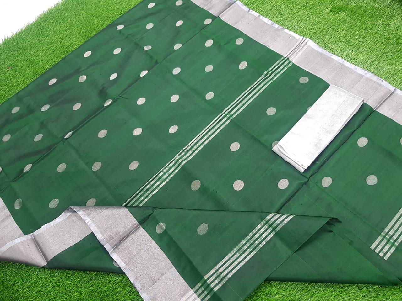 Deep green uppada pure soft pattu with silver border saree