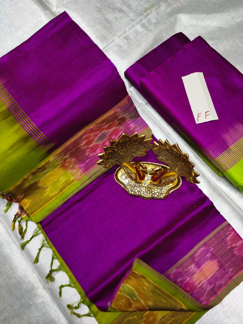 Purple and Green Tripura silk saree with pochampalli border