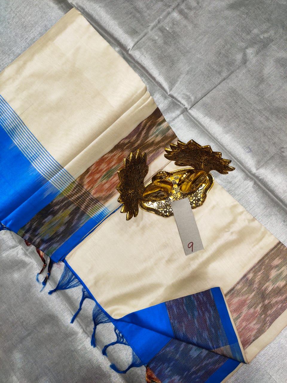 Cream and Blue Tripura silk saree with pochampalli border