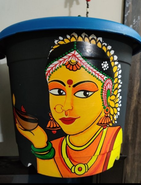 Traditional  Indian lady hand panted planter