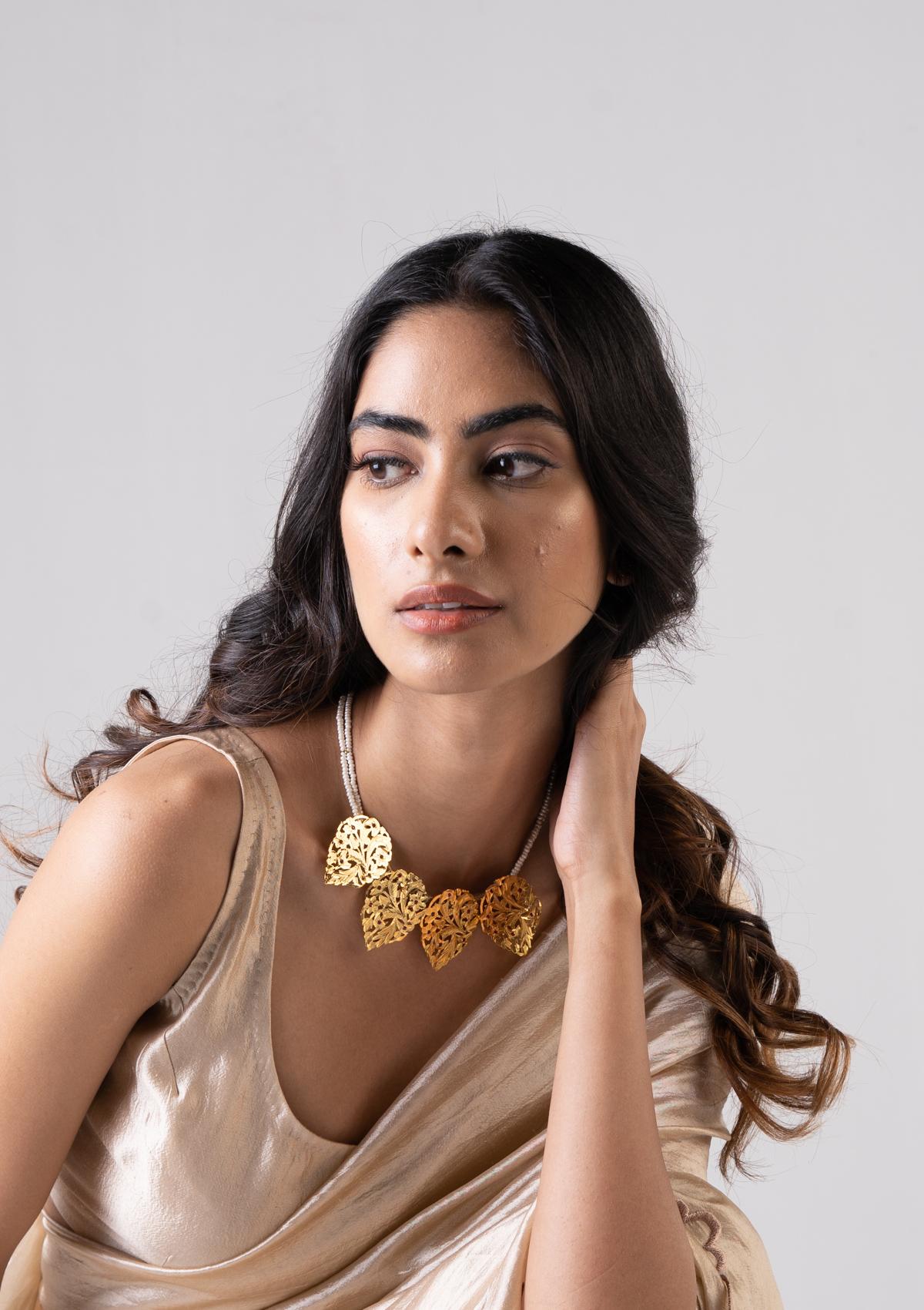 Husaina Gold Tone Silver Necklace