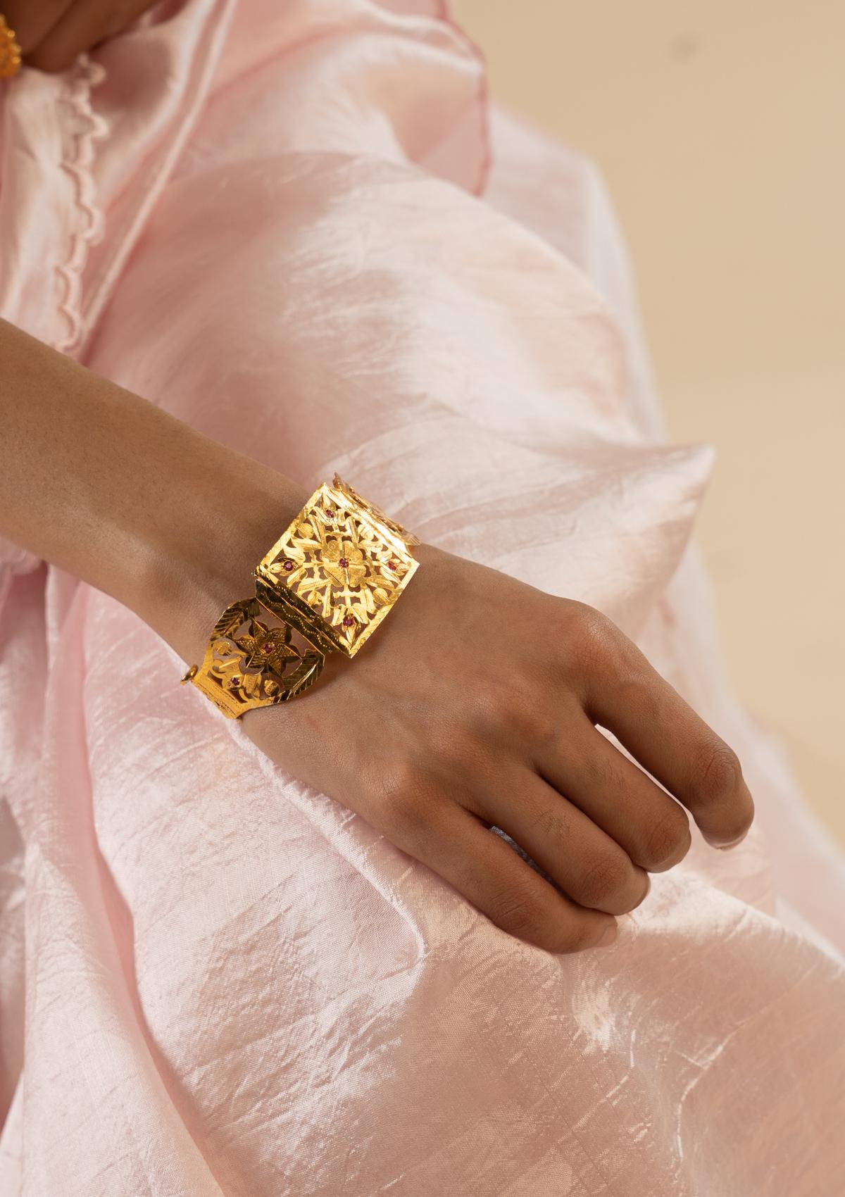 Madri Gold Tone Silver Bangle