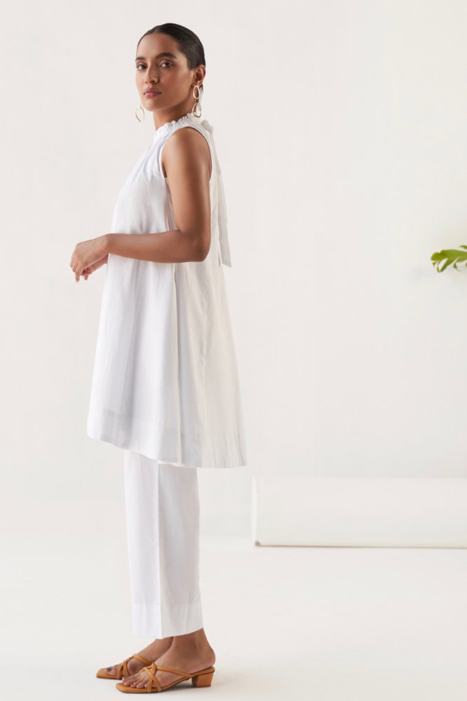 MARRAKESH SOLID WHITE FINE COTTON FABRIC SLEEVELESS TUNIC WITH  WHITE STRAIGHT FIT PANTS  CO-ORDINATE