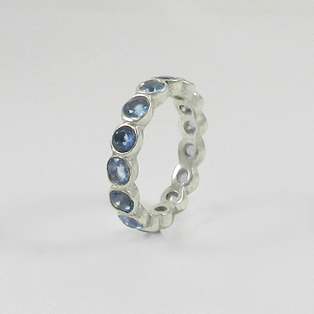 Sky blue topaz hydro silver eternity ring