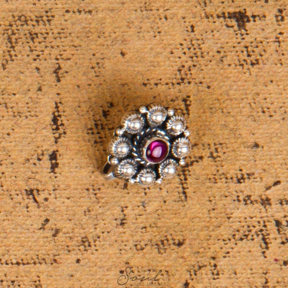 Round flower with gemstone